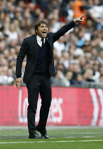 Chelsea's coach Antonio Conte gestures during their FA Cup semi-final football match against Tottenham Hotspur at Wembley stadium in London on April 22, 2017