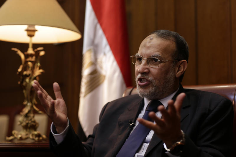 "FILE - In this Monday, June 17, 2013 file photo, Egyptian Shura council member and vice president of the Muslim Brotherhood's Freedom and Justice Party Essam el-Erian speaks during an interview with the Associated Press in his office at the Shura Council, in Cairo, Egypt. Egypt's Muslim Brotherhood is ramping up calls for nationwide protests, urging people to take to the streets against the new military-backed government. In a pre-recorded message aired late Wednesday on one of Al-Jazeera's Arabic news channels, el-Erian called on people to rise against the ""failed, bloody military regime."" (AP Photo/Hassan Ammar, File)"