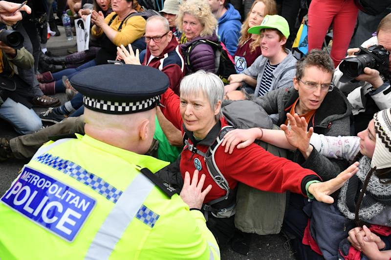 A police officer talks to a protester in a blockade on Waterloo Bridge (Getty Images)