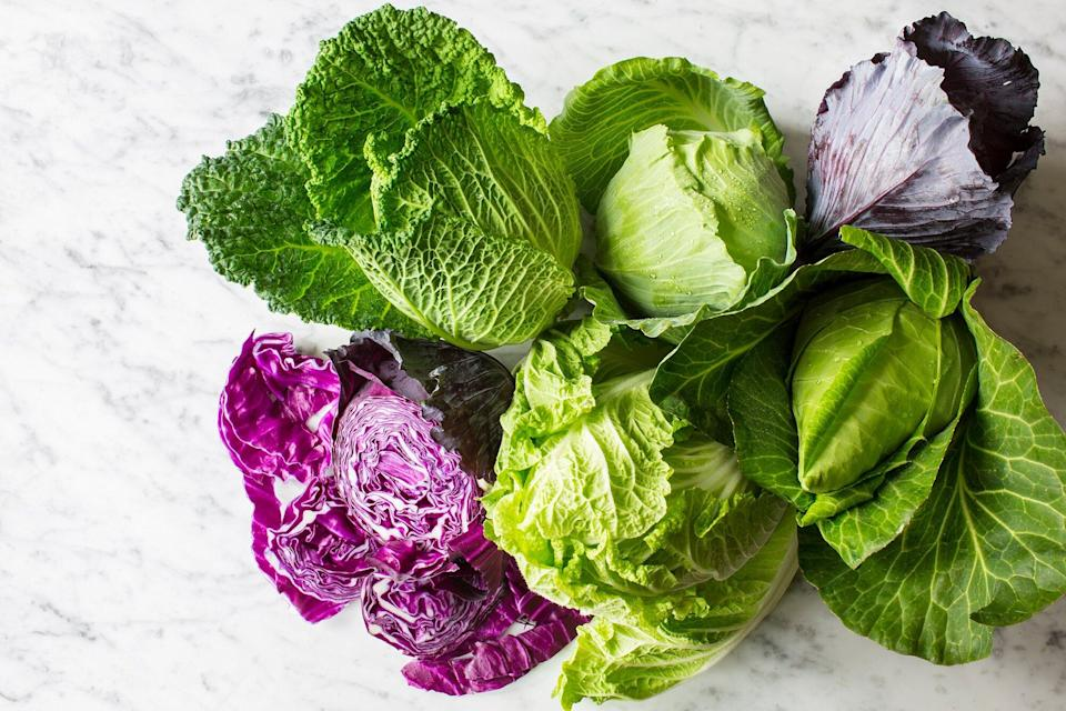 four heads of cabbage on a white background