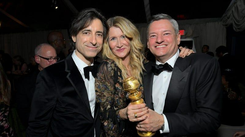Noah Baumbach, Laura Dern, and Netflix co-CEO Ted Sarandos awkwardly try to share Dern's Marriage Story Golden Globe in 2020.
