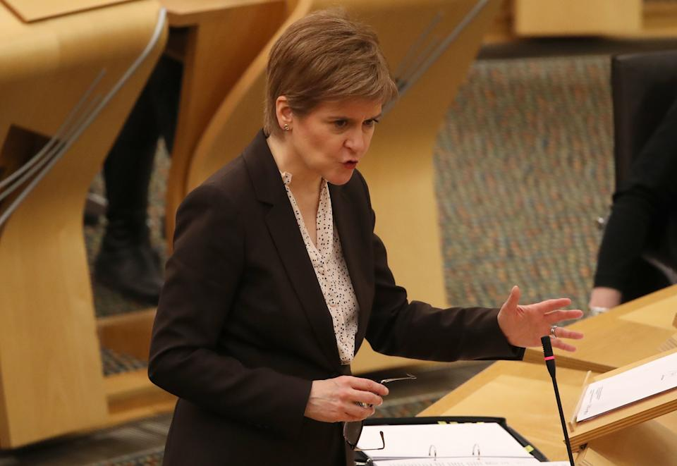 EDINBURGH, SCOTLAND - JANUARY 04: Scottish First Minister, Nicola Sturgeon reacts as she delivers a statement at Holyrood, Edinburgh, announcing that Scotland will be placed in lockdown from midnight for the duration of January with a legal requirement to stay at home except for essential purposes on January 4, 2021 in Edinburgh, Scotland. (Photo by Andrew Milligan - WPA Pool/Getty Images)