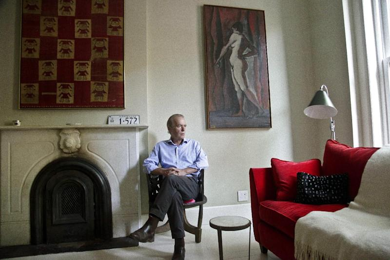 """This Aug. 17, 2012 photo shows British novelist Martin Amis pose in the living room of his new home in the Brooklyn borough of New York.  Amis's new novel is titled """"Lionel Asbo: State of England.""""  (AP Photo/Bebeto Matthews)"""