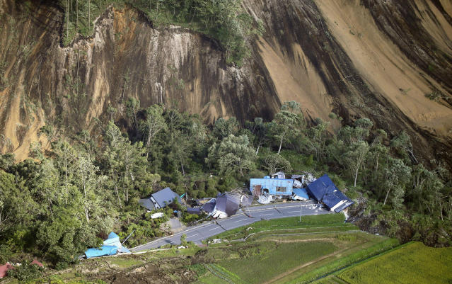 <p>This aerial photo shows houses destroyed by a landslide after an earthquake in Atsuma town, Hokkaido, northern Japan, Thursday, Sept. 6, 2018. A powerful earthquake rocked Japan's northernmost main island of Hokkaido early Thursday, triggering landslides that crushed homes, knocking out power across the island, and forcing a nuclear power plant to switch to a backup generator. (Kyodo News via AP)</p>