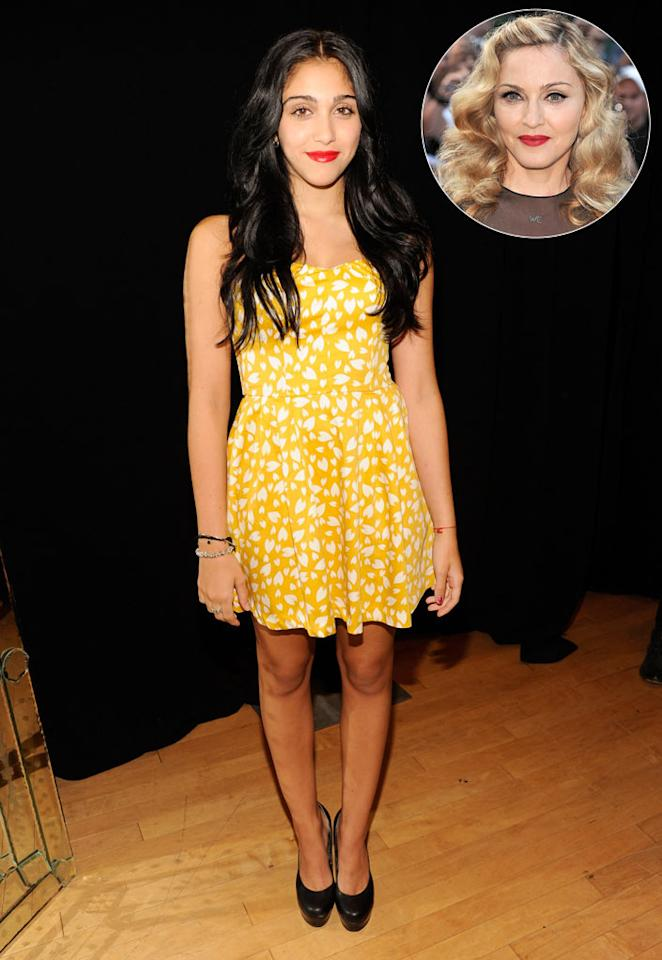"""Lourdes """"Lola"""" Leon bore a striking resemblance to her mother, Madonna, while celebrating the 1-year anniversary of their Material Girl fashion line on Tuesday night at Macy's Herald Square. The soon-to-be 15-year-old looked absolutely adorable in a self-designed, white-and-yellow strapless mini, black platform pumps, and bright red lips. Kevin Mazur/<a href=""""http://www.wireimage.com"""" target=""""new"""">WireImage.com</a> - September 20, 2011"""
