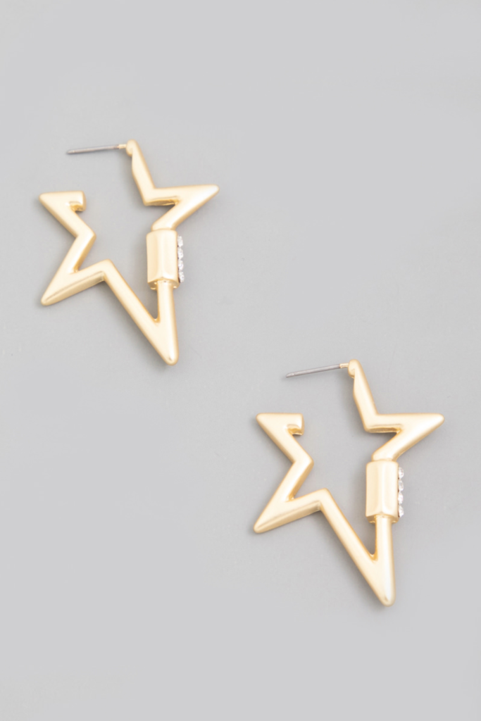 """<p><strong>Humans Before Handles</strong></p><p>humansbeforehandles.com</p><p><strong>$36.00</strong></p><p><a href=""""https://www.humansbeforehandles.com/collections/earrings/products/zenon"""" rel=""""nofollow noopener"""" target=""""_blank"""" data-ylk=""""slk:Shop Now"""" class=""""link rapid-noclick-resp"""">Shop Now</a></p><p>Okay, wow, I'm only wearing star-shaped hoops from now on. </p>"""
