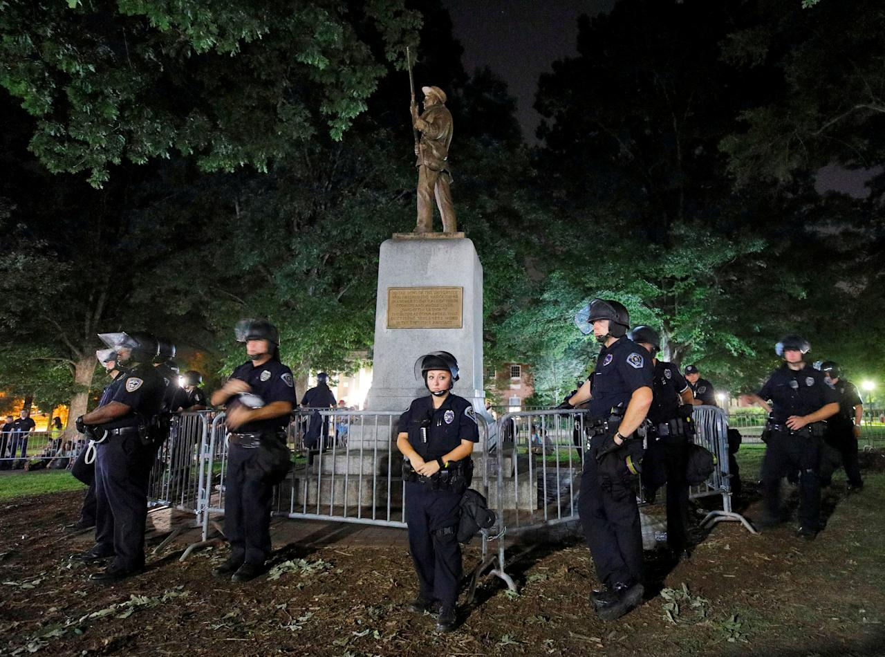 <p>Police wearing riot gear guard a statue of a Confederate soldier nicknamed Silent Sam on the campus of the University of North Carolina during a demonstration for its removal in Chapel Hill, N.C., Aug. 22, 2017. (Photo: Jonathan Drake/Reuters) </p>