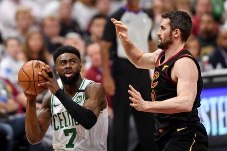 May 25, 2018; Cleveland, OH, USA; Boston Celtics guard Jaylen Brown (7) shoots the ball against Cleveland Cavaliers center Kevin Love (0) in game six of the Eastern conference finals of the 2018 NBA Playoffs at Quicken Loans Arena. Mandatory Credit: Ken Blaze-USA TODAY Sports