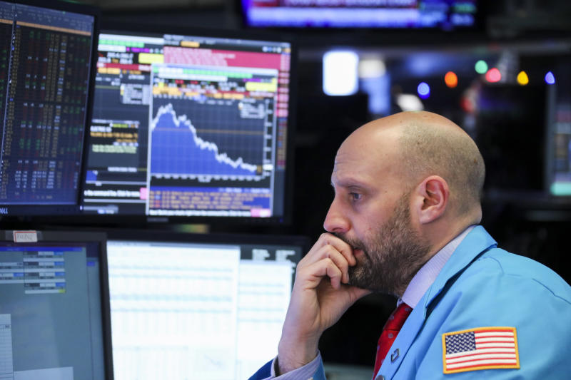 NEW YORK, Dec. 5, 2018 -- A trader works at the New York Stock Exchange in New York, the United States, Dec. 4, 2018. U.S. stocks plunged on Tuesday, with all three major indices erasing more than 3 percent, amid worries over inverted yield curve signaling a possible economic slowdown. The Dow Jones Industrial Average decreased 799.36 points, or 3.10 percent, to 25,027.07. The S&P 500 decreased 90.31 points, or 3.24 percent, to 2,700.06. The Nasdaq Composite Index fell 283.09 points, or 3.80 percent, to 7,158.43. (Xinhua/Wang Ying) (Xinhua/Wang Ying via Getty Images)