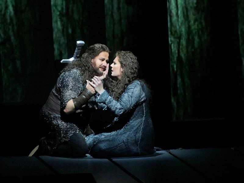 "This April 28, 2012 photo provided by the Metropolitan Opera shows Frank Van Aken as Siegmund and Eva-Maria Westbroek as Sieglinde during their performance in Wagner's ""Die Walkure,"" at the Metropolitan Opera in New York. On May 12 the Met concludes the last of three complete presentations of Robert Lepage's production of the four-opera Ring Cycle, which includes Das Rheingold; Die Walkure; Siegfried and Gotterdammerung. (AP Photo/The Metropolitan Opera, Ken Howard)"