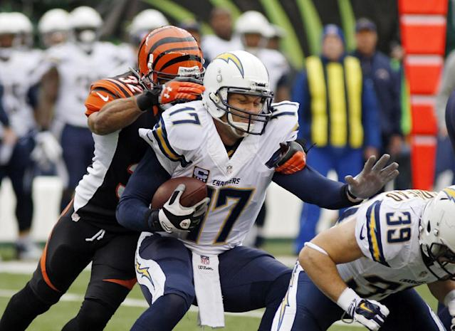San Diego Chargers quarterback Philip Rivers (17) is sacked by Cincinnati Bengals safety Chris Crocker in the first half of an NFL wild-card playoff football game Sunday, Jan. 5, 2014, in Cincinnati. (AP Photo/David Kohl)