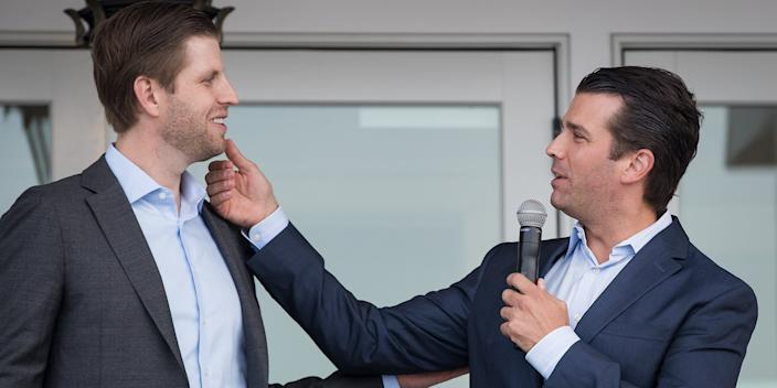 Eric Trump and Donald Trump Jr. speak during a ribbon cutting event at Trump Golf Links at Ferry Point in The Bronx.