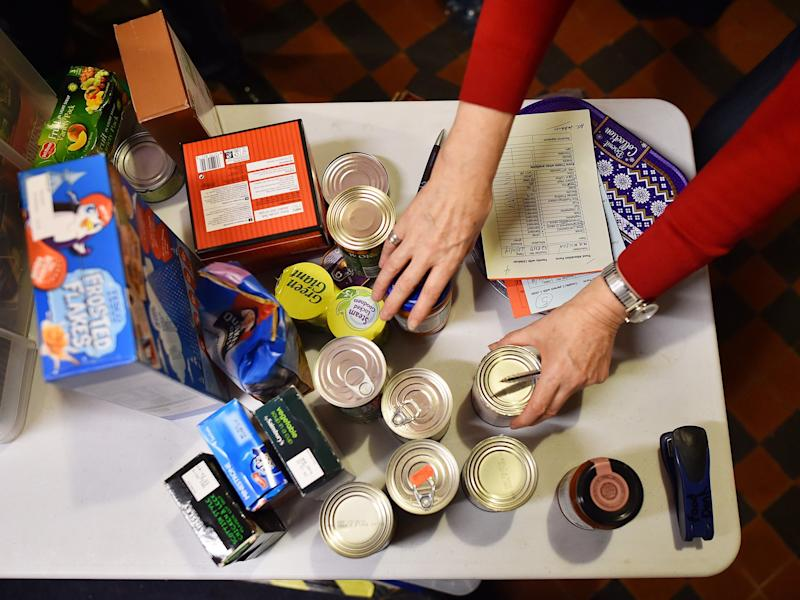 The number of people using food banks has risen by seven per cent in the last year: Getty