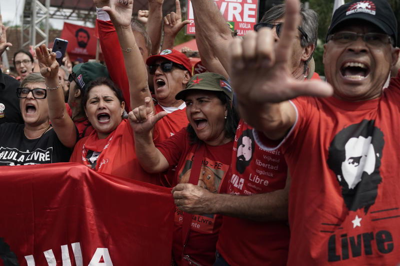 "Supporters of Brazil's former President Luiz Inacio Lula da Silva shout ""Good afternoon Lula"" outside the Federal Police headquarters where the former leader is imprisoned in Curitiba, Brazil, Friday, Nov. 8, 2019. Da Silva's lawyers have begun legal procedures requesting his release from prison, following a Supreme Court decision late Thursday that a person can be imprisoned only after all appeals to higher courts have been exhausted. Da Silva has been detained since April 2018 after being convicted of corruption. (AP Photo/Leo Correa)"