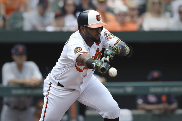 Baltimore Orioles' Hanser Alberto bunts for a base hit against the Detroit Tigers in the first inning of a baseball game Monday, May 27, 2019, in Baltimore, Md. (AP Photo/Gail Burton)