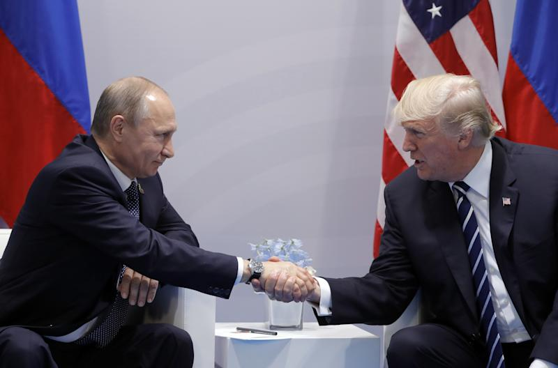 Russia's President Vladimir Putin and President Donald Trump shake hands during a bilateral meeting on the sidelines of the G-20 summit in Hamburg (Mikhail Metzel via Getty Images)