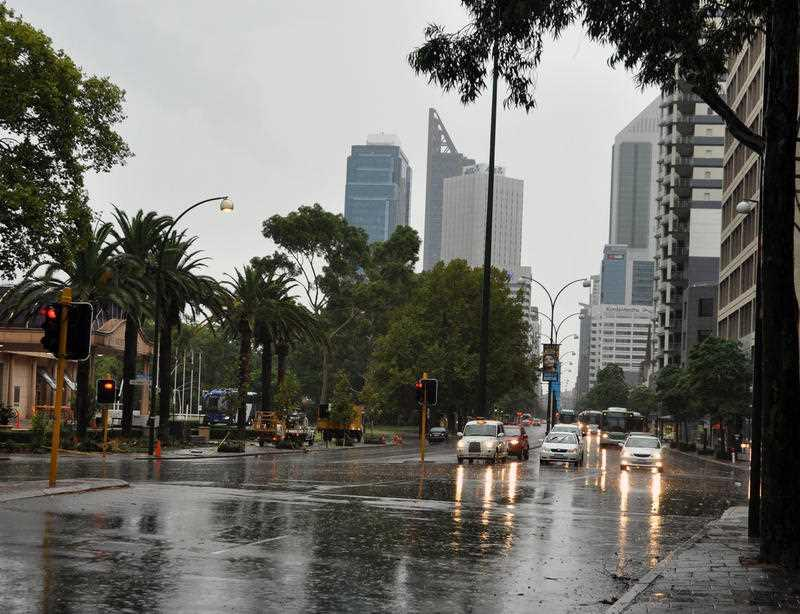 St Georges Terrace is inundated with rain following a storm in Perth.