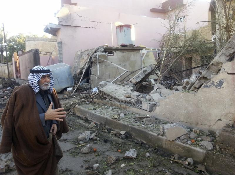 A man looks at the site of a car bomb attack in the town of Tuz Khurmatu