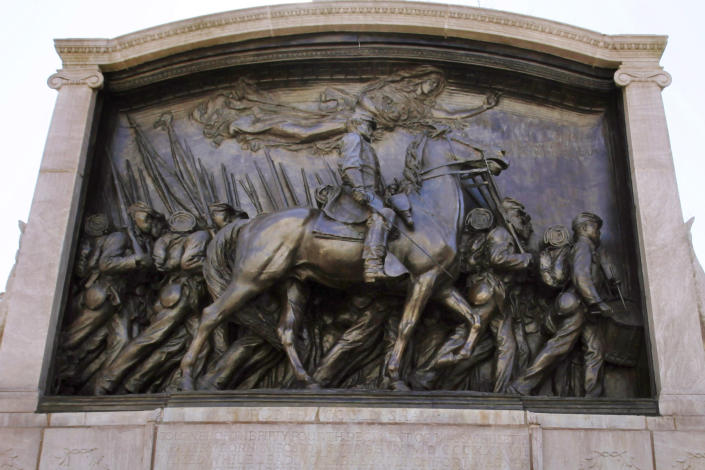 FILE - In this March 26, 2011, file photo, soldier and cavalry details are displayed on the memorial to Union Col. Robert Gould Shaw and the 54th Massachusetts Volunteer Infantry Regiment, near the Statehouse in Boston. The monument in downtown Boston honoring a famed Civil War unit of Black soldiers is being fully unveiled to the public Friday, May 28 following a $3 million restoration. (AP Photo/Michael Dwyer, File)