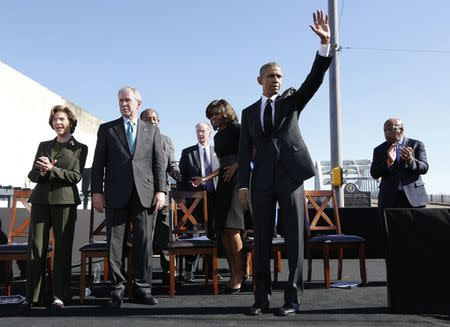 U.S. President Barack Obama (2nd R) acknowledges the crowd after remarks at the Edmund Pettus Bridge in Selma, Alabama, March 7, 2015. REUTERS/Jonathan Ernst