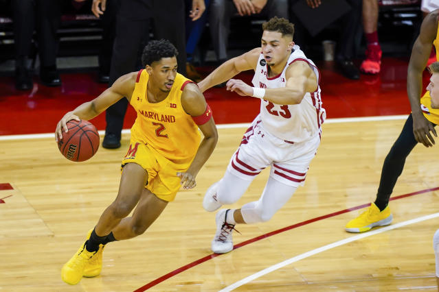 Maryland's Aaron Wiggins (2) drives around Wisconsin's Kobe King (23) during the first half of an NCAA college basketball game Tuesday, Jan. 14, 2020, in Madison, Wis. (AP Photo/Andy Manis)