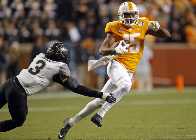 Tennessee wide receiver Jauan Jennings (15) gets past Vanderbilt safety Tae Daley (3) in the second half of an NCAA college football game Saturday, Nov. 30, 2019, in Knoxville, Tenn. (AP Photo/Wade Payne)
