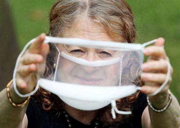 PHOTO: Arlene Romoff holds up a clear mask like the one she is wearing that helps her and others with hearing impairments read lips of doctors and other medical providers in Hackensack, N.J., July 9. 2020. (NorthJersey.com via USA Today Network, FILE)