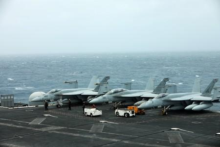 U.S. aircrafts are seen on the deck of USS Abraham Lincoln in the Gulf of Oman near the Strait of Hormuz