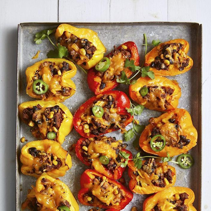 """<p>Take your typical nachos to the next level by replacing tortilla chips with beta carotene- and vitamin C-packed bell peppers. </p><p><em><a href=""""https://www.womansday.com/food-recipes/a34145180/bell-pepper-nachos-recipe/"""" rel=""""nofollow noopener"""" target=""""_blank"""" data-ylk=""""slk:Get the Bell Pepper Nachos recipe."""" class=""""link rapid-noclick-resp"""">Get the Bell Pepper Nachos recipe.</a></em></p>"""