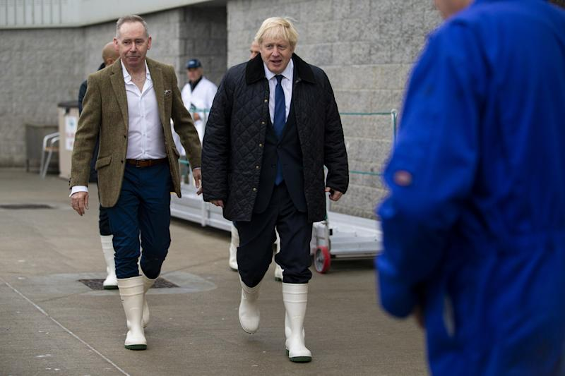 Britain's Prime Minister Boris Johnson walks with Simon Brebner around Peterhead Fish Market in Aberdeen, Scotland, Britain September 6, 2019. Duncan McGlynn/Pool via REUTERS