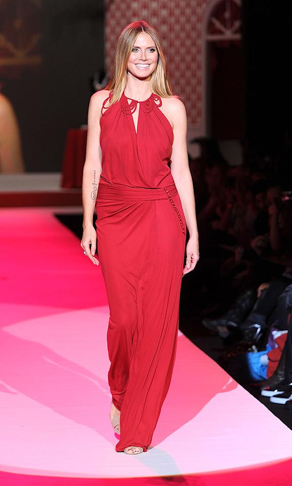 """Heidi Klum took to the runway at the Heart Truth Fall 2010 Fashion Show in a stunning John Galliano gown. Since 2002, the Red Dress collection has appeared at New York Fashion Week to raise awareness amongst women about the dangers of heart disease. Frazer Harrison/Getty Images for Heart Truth/<a href=""""http://www.gettyimages.com/"""" target=""""new"""">GettyImages.com</a> - February 11, 2010"""