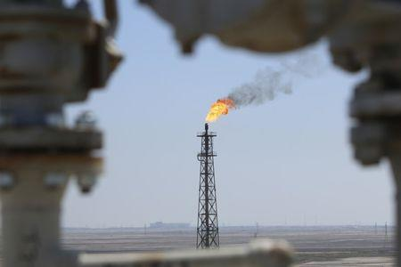 Gas burns off at the al-Shuaiba oil refinery in southwest Basra
