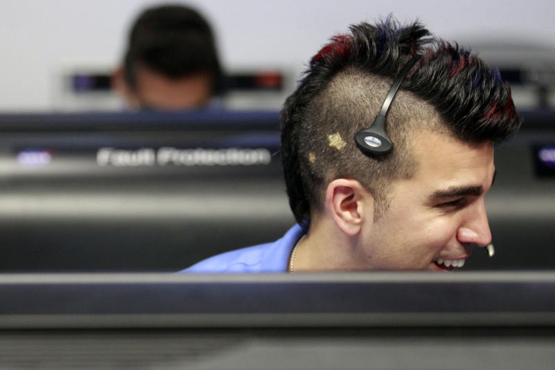 FILE -In this Sunday Aug. 5, 2012 file photo,  flight director for the Mars rover Curiosity Bobak Ferdowsi, who cuts his hair differently for each mission, works inside the Spaceflight Operations Facility for NASA's Mars Science Laboratory Curiosity rover at Jet Propulsion Laboratory, JPL in Pasadena, Calif. on Sunday, Aug. 5, 2012. The Curiosity robot is equipped with a nuclear-powered lab capable of vaporizing rocks and ingesting soil, measuring habitability, and potentially paving the way for human exploration. (AP Photo/Los Angeles Times, Brian van der Brug, Pool)