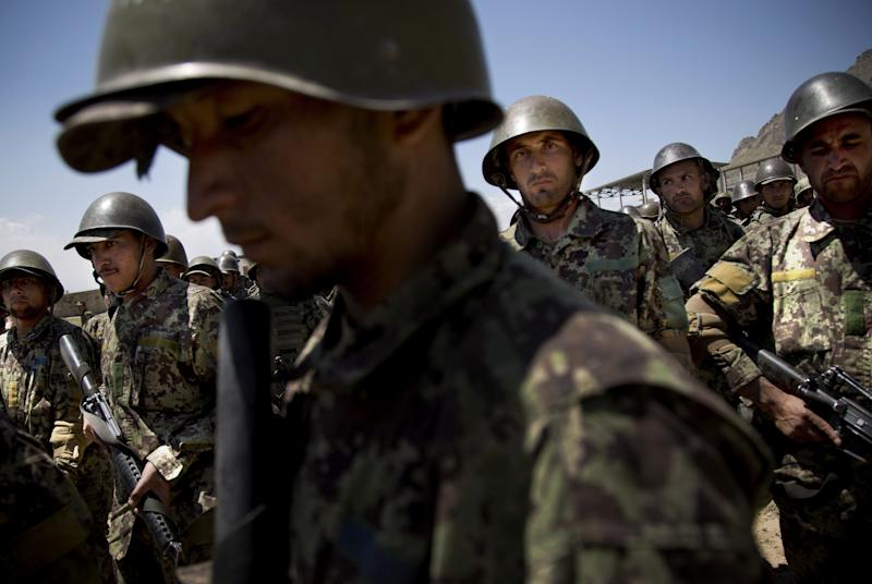 Afghan Army soldiers gather at a training facility on the outskirts of Kabul, Afghanistan, Wednesday, May 8, 2013. Afghanistan had claimed earlier this week that its forces were fired on in the Goshta district of Afghanistan's eastern Nangarhar province, the same place where a firefight between Afghan and Pakistani forces left an Afghan border policeman dead and two Pakistani soldiers wounded last week. Relations between the two neighbors have been severely strained between the two sides over the demarcation of their border. (AP Photo/Anja Niedringhaus)