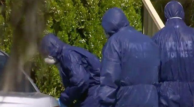 Forensic police investigate the scene near the family car. Source: 7 News