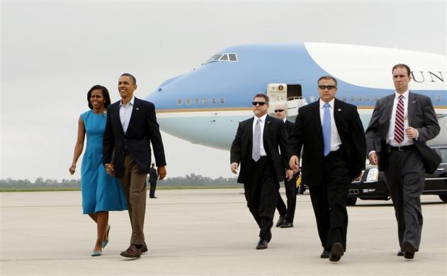 President Barack Obama and first lady Michelle Obama walk from Air Force One upon their arrival in Columbus, Ohio May 5, 2012.