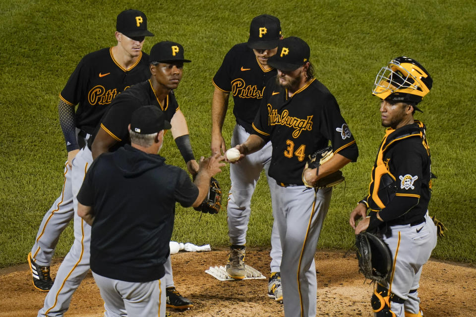 Pittsburgh Pirates starting pitcher JT Brubaker (34) hands the ball to manager Derek Shelton during the sixth inning of a baseball game against the New York Mets, Friday, July 9, 2021, in New York. (AP Photo/Frank Franklin II)