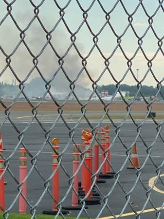 Smoke is seen from Windsor Locks at the site of an airplane crash in Bradley International Airport, Connecticut