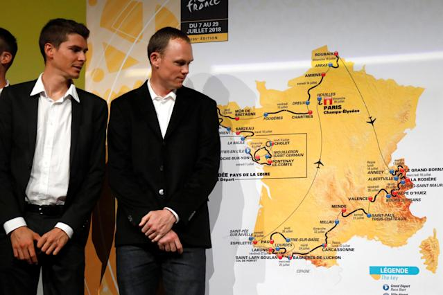 Tour de France 2017 winner Chris Froome of Britain (R) and rider Warren Barguil look at the map of the itinerary of the 2018 Tour de France cycling race during a news conference in Paris, France, October 17, 2017. The world's greatest cycling event will start from Noirmoutier-en-L'Ile on July 7 and will finish at the Champs Elysees in Paris on July 29. REUTERS/Charles Platiau