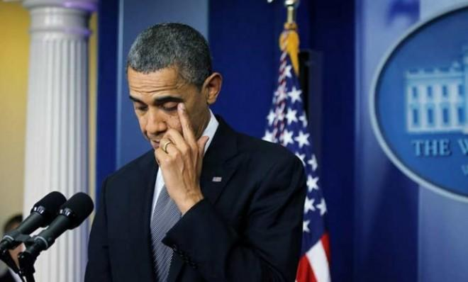 President Obama wipes a tear during his emotional statement on the Connecticut massacre.
