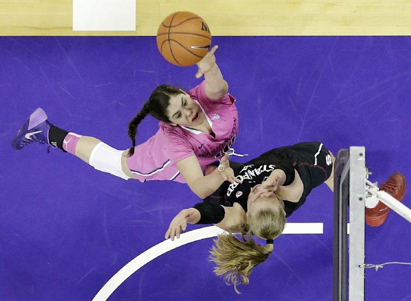 Washington's Kelsey Plum, left, puts a shot up over Stanford's Mikaela Ruef in the first half of an NCAA women's basketball game, Sunday, Feb. 9, 2014, in Seattle. (AP Photo/Elaine Thompson)