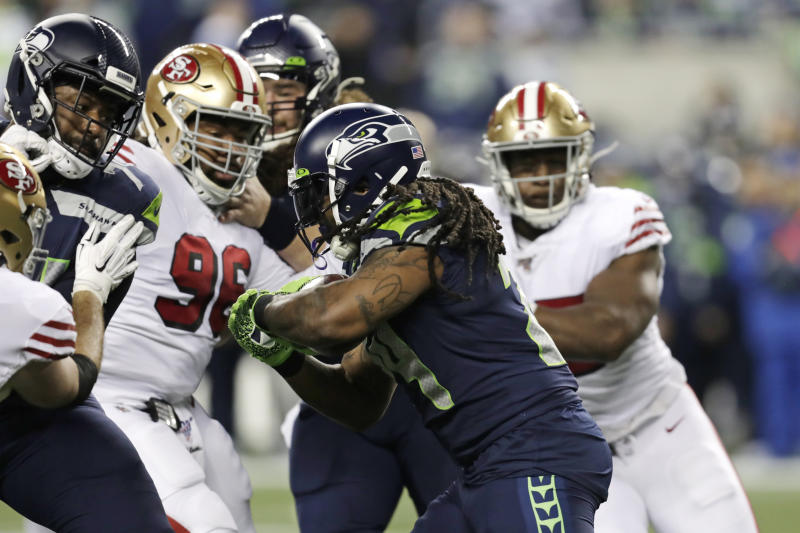Seattle Seahawks running back Marshawn Lynch, center, was stopped on a key fourth down against the 49ers. (AP Photo/Stephen Brashear)