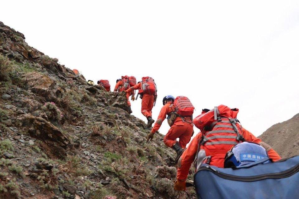 Rescuers search for victims after the Baiyun marathon disaster. Photo: Xinhua