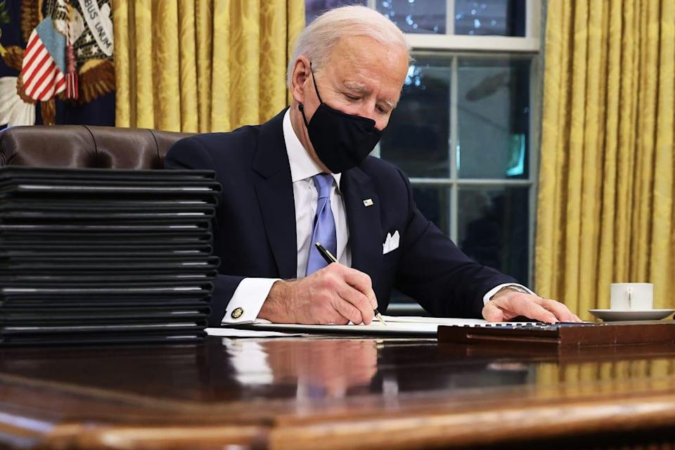 "<div class=""inline-image__title"">1297494723</div> <div class=""inline-image__caption""><p>U.S. President Joe Biden prepares to sign a series of executive orders at the Resolute Desk in the Oval Office just hours after his inauguration on January 20, 2021 in Washington, DC. Biden became the 46th president of the United States earlier today during the ceremony at the U.S. Capitol. </p></div> <div class=""inline-image__credit"">Chip Somodevilla/Getty</div>"