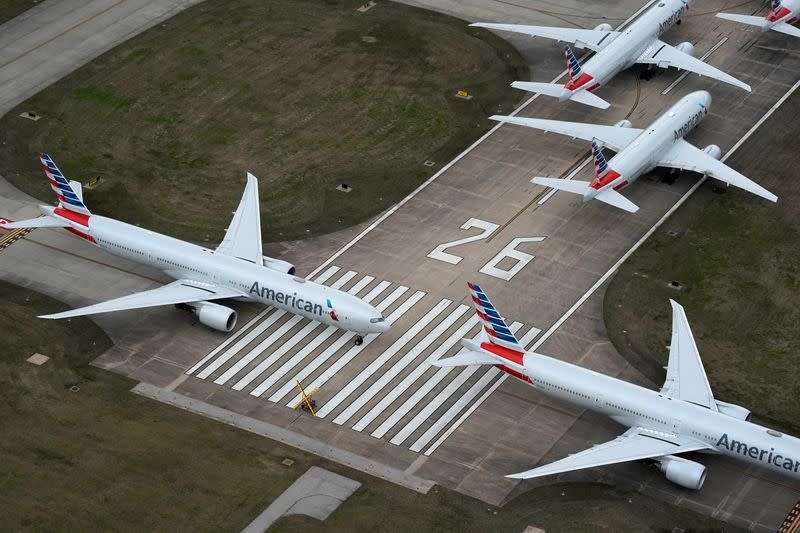 American Airlines passenger planes crowd a runway in Tulsa