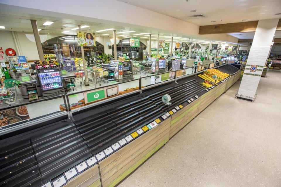 Empty Woolworths fresh produce shelves make statement about Australian bee population impact food supply