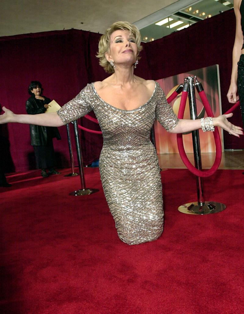 Joan Rivers of E! welcomes back the red carpet before the start of the 53rd annual Primetime Emmy Awards at the Shubert Theatre on Sunday, Nov. 4, 2001, in Los Angeles. (AP Photo/Kim D. Johnson)