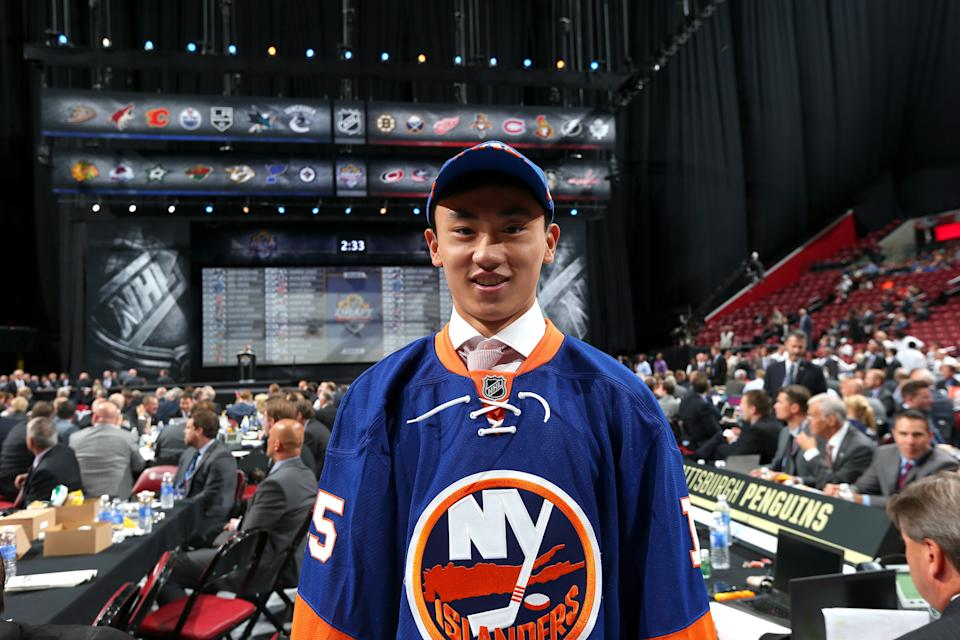 SUNRISE, FL - JUNE 27:  AnDong Song reacts after being selected 172nd overall by the New York Islanders during the 2015 NHL Draft at BB&T Center on June 27, 2015 in Sunrise, Florida.  (Photo by Bruce Bennett/Getty Images)