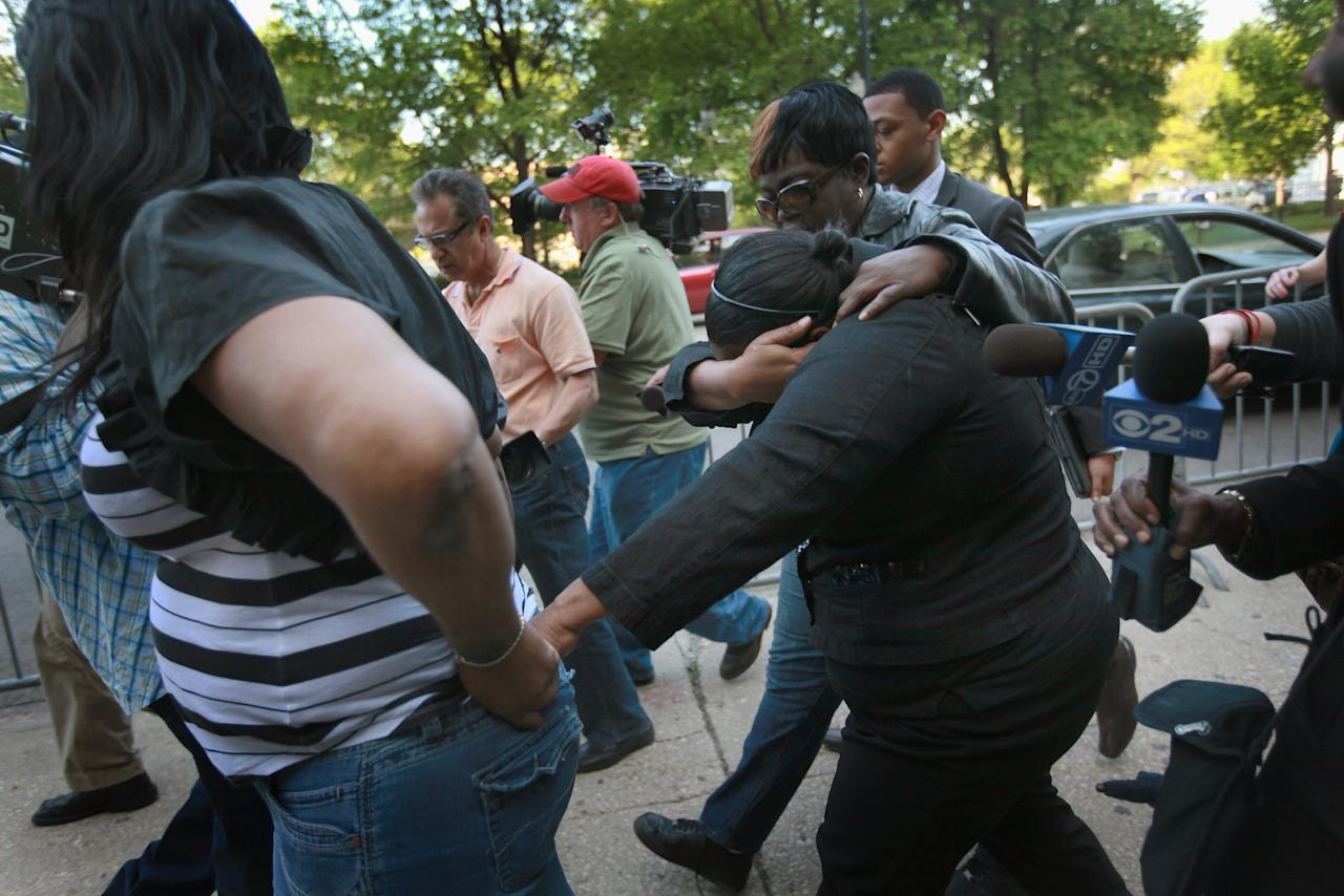 CHICAGO, IL - MAY 11:  Michele Davis-Balfour (C) shields her face as she leaves the Cook County Courthouse after learning her son William Balfour had been found guilty in the October 2008 shooting deaths of the mother, brother and nephew of Oscar-winner Jennifer Hudson's May 11, 2012 in Chicago, Illinois.  Balfour, the ex-husband of Hudson's sister, has been convicted on all of the counts against him, including three counts of first-degree murder, one count of home invasion, one count aggravated kidnapping, one count residential burglary, and one count possession of a stolen motor vehicle.  (Photo by Scott Olson/Getty Images)