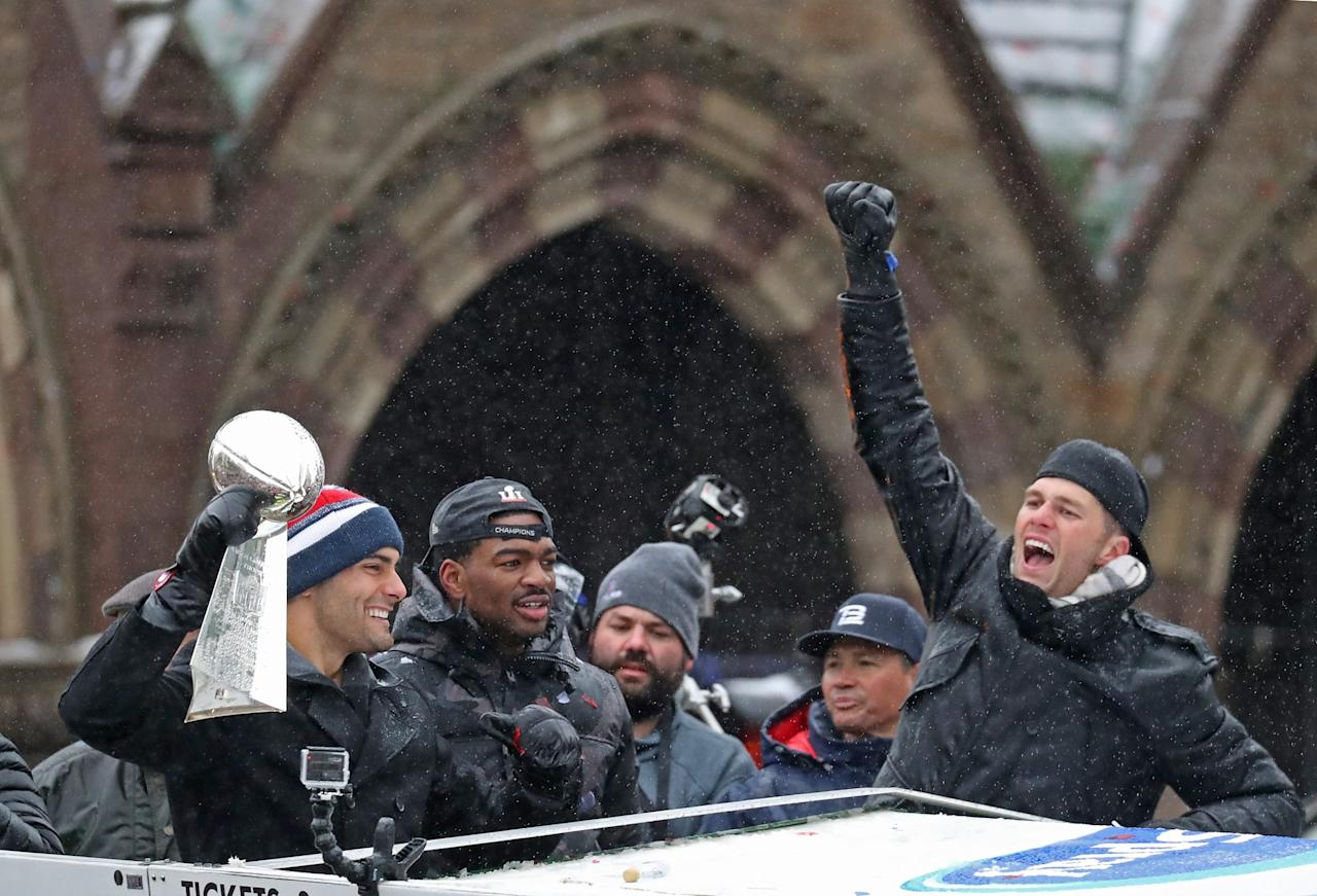 <p>New England Patriots' Jimmy Garoppolo, Jacoby Brissett and Tom Brady celebrate during the New England Patriots Super Bowl LI Victory Parade in Boston on Feb. 7, 2017. (Photo by David L. Ryan/The Boston Globe via Getty Images) </p>